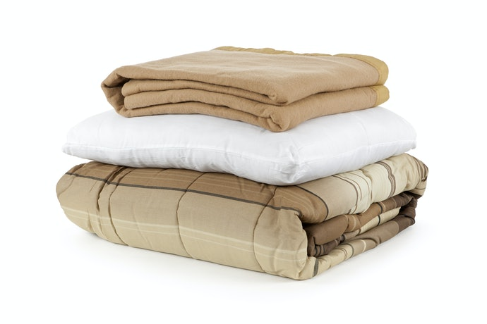 Qual a Diferença Entre Cobertor, Edredom e Manta?