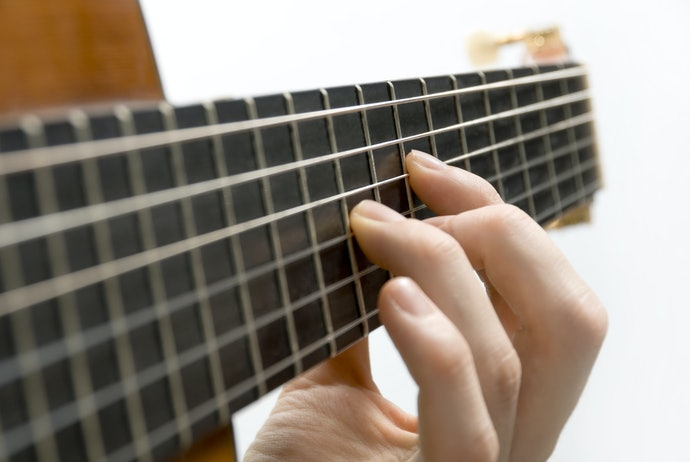 To Improve Playability, Check the String Material